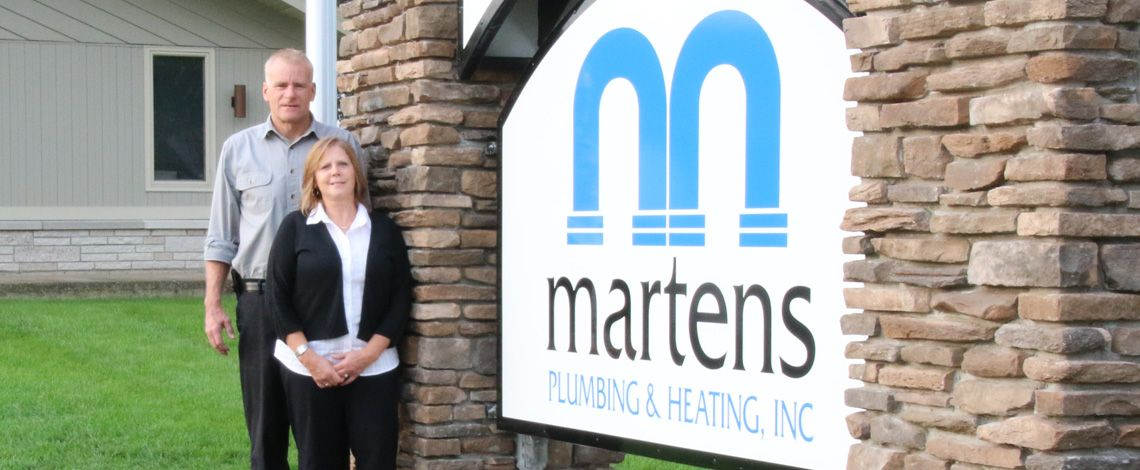 martens plumbing sign and owners