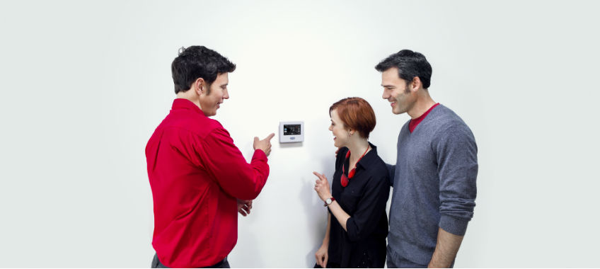 technician explaining thermostat use