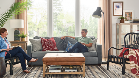 Homeowners enjoy humidifier benefits as they relax on the couch.