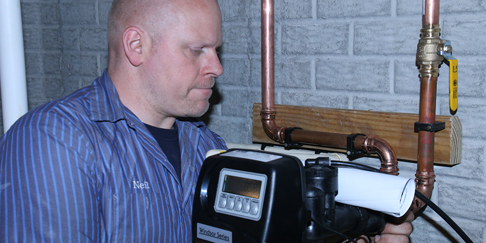 Martens technician makes plumbing upgrades to home including replacing a water heater.