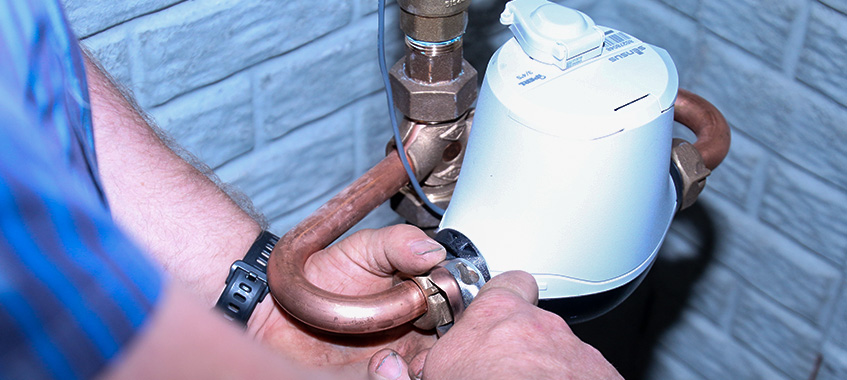 Plumbing specialist installing a water meter to diagnose water problems